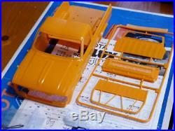 Nichimo Toyota 4x4 Pickup Hilux 4WD 1/20 Orange plastic model automobile unused